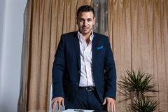 Middle Eastern businessman in the office. Middle Eastern businessman standing on front of the desk stock photo