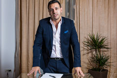 Middle Eastern businessman in the office. Middle Eastern businessman standing in front of the desk royalty free stock photos