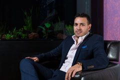 Middle Eastern businessman in the office. Middle Eastern businessman standing in front of the desk royalty free stock image
