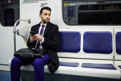 Middle-Eastern Businessman on Subway train royalty free stock photo