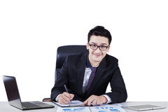 Middle eastern businessman working on desk Stock Images