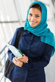 Middle eastern college girl. Beautiful middle eastern college girl holding books Stock Images