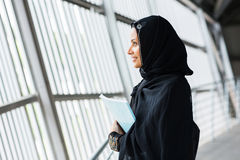 Middle eastern college girl daydreaming. Side view of pretty middle eastern college girl daydreaming Royalty Free Stock Photo