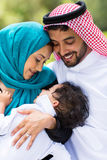 Middle eastern couple and baby boy. Happy middle eastern couple and baby boy outdoors Stock Photo