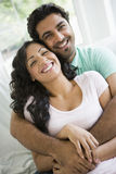 A Middle Eastern couple cuddling. Looking at camera stock photos