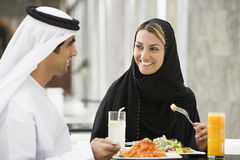 Middle Eastern Couple Eating A Meal Stock Images