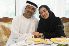 A Middle Eastern couple enjoying a meal Royalty Free Stock Photography