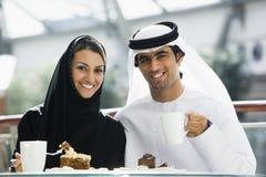 A Middle Eastern couple enjoying a meal. A Middle Eastern family enjoying a meal in a restaurant stock photos