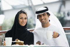 A Middle Eastern couple enjoying a meal. In a restaurant royalty free stock photography
