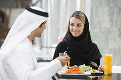 A Middle Eastern couple enjoying a meal. In a restaurant stock images