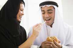 A Middle Eastern couple sharing a fast food meal Stock Image