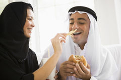 A Middle Eastern couple sharing a fast food meal Stock Photography
