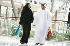 A Middle Eastern couple in a shopping mall Stock Photo