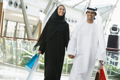 A Middle Eastern couple in a shopping mall.  Royalty Free Stock Photo