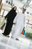A Middle Eastern couple in a shopping mall Royalty Free Stock Photos