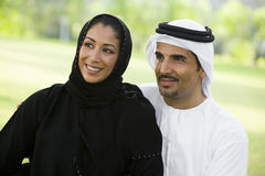 A Middle Eastern couple sitting in a park Royalty Free Stock Image