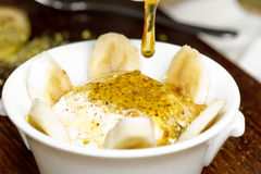 Middle eastern creamy dessert with nuts and honey / ashta w assal.  stock images