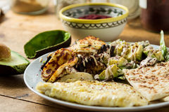 Middle Eastern cuisine: halloumi salad with avocado, herbs and s Stock Photography