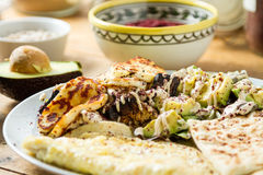 Middle Eastern cuisine: halloumi salad with avocado, herbs and s Royalty Free Stock Images