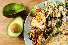 Middle Eastern cuisine: halloumi salad with avocado, herbs and s Royalty Free Stock Photos