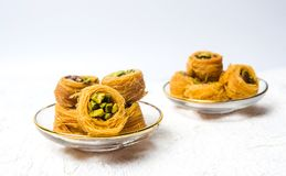 Middle Eastern dessert with pistachio. On white royalty free stock images