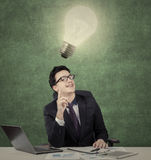 Middle eastern entrepreneur gets idea under lamp Royalty Free Stock Image