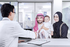 Middle eastern families handshake with pediatrician Royalty Free Stock Images