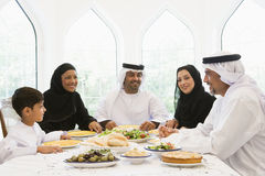 A Middle Eastern family enjoying a meal royalty free stock image
