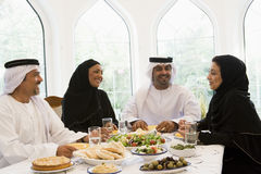 A Middle Eastern family enjoying a meal Royalty Free Stock Photography