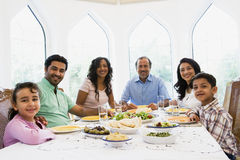 A Middle Eastern family enjoying a meal together stock photo