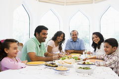 A Middle Eastern family enjoying a meal together stock photos
