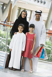 A Middle Eastern family in a shopping mall stock photo