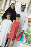 A Middle Eastern family in a shopping mall Stock Photos