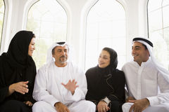 A Middle Eastern family sitting together Royalty Free Stock Photos