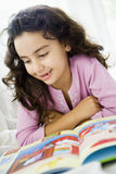 Middle Eastern girl reading Stock Photo