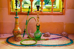 Middle Eastern Hookah (Hubbly Bubbly Pipes). A display of Middle Eastern pipes used for smoking tobacco stock photos