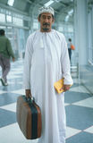 Middle Eastern man in airport terminal Royalty Free Stock Photos