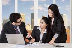 Middle eastern man discussing with his partners Stock Images