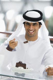 A Middle Eastern man enjoying a meal royalty free stock photo