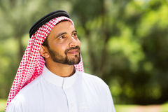 Middle eastern man. Handsome middle eastern man looking up outdoors royalty free stock photos