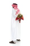 Middle eastern man hides behind a roses Royalty Free Stock Images
