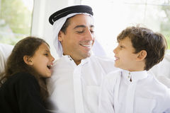 A Middle Eastern man with his children.  royalty free stock photo