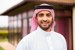 Middle eastern man outside. Portrait of middle eastern man outside the house stock photo