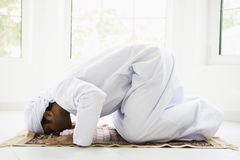 A Middle Eastern man praying.  Royalty Free Stock Images
