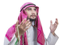 Middle eastern man praying with chaplet Stock Photos