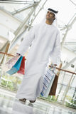 A Middle Eastern man in a shopping mall royalty free stock photography