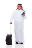 Middle eastern man travel. Smiling middle eastern man with travel luggage and air ticket isolated on white royalty free stock photography