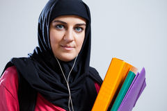 Middle Eastern student holding documents Royalty Free Stock Images