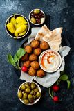 Middle Eastern traditional dinner. Authentic arab cuisine. Meze party food. Top view, flat lay, overhead royalty free stock images