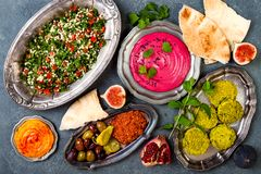 Middle Eastern traditional dinner. Authentic arab cuisine. Meze party food. Top view, flat lay. Overhead stock photo